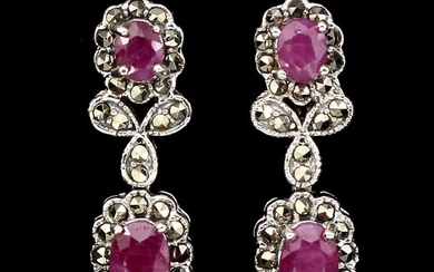 A pair of ruby and marcasite ear pendants each set with two oval-cut rubies and numerous circular-cut marcasites, mounted in rhodium plated sterling silver.