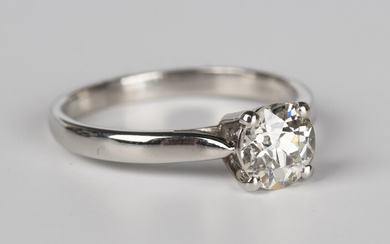 A platinum and diamond single stone ring, claw set with a circular cut diamond, detailed 'Plat&