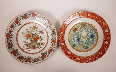 A polychrome porcelain cabinet plate with enamelled decorati...