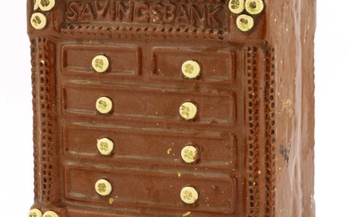 A pottery chest of drawers money bank