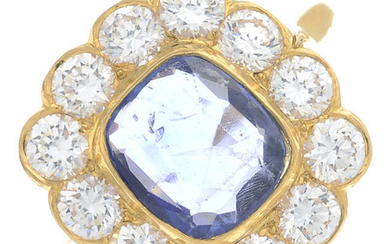 A sapphire and cubic zirconia cluster ring.