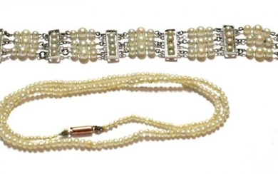 A three row cultured pearl bracelet with cultured pearl panels...