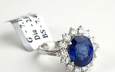 AN 18CT WHITE GOLD, 7.4CT OVAL CUT SAPPHIRE AND 2.01CT ROUND...