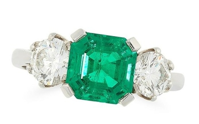 AN EMERALD AND DIAMOND THREE STONE RING in platinum