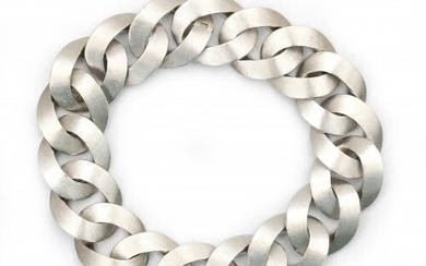 An 18 carat white gold twisted link bracelet. Composed of a series of brushed flat shaped links to an invisible clasp. Gross weight: 76.4 g.
