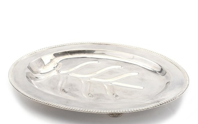An American 20th century sterling silver serving dish on four feet. Maker Brand Chatillon, New York.