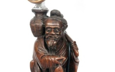 An early 20th Century Japanese rootwood figure of a fisherma...