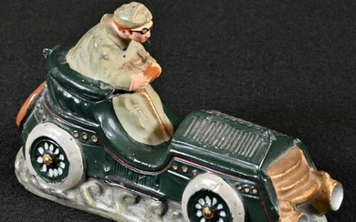 An early 20th century diecast novelty inkwell, cast as a gen...