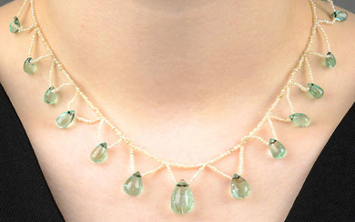 An early 20th century green beryl and seed pearl fringe necklace.