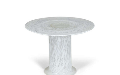 COFFEE TABLE A circular glass coffee table, on...