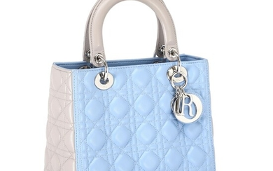 """Christian Dior: A """"Lady Dior"""" bag made of blue and grey quilted leather with silver..."""