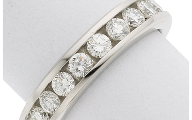 Diamond, Platinum Ring The band features full-cut diamonds weighing...