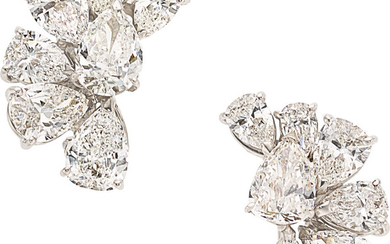 Diamond, White Gold Earrings The earrings feature two pear-shaped...
