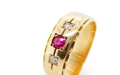 Diamond and ruby set yellow gold ring Unmarked. With feather...