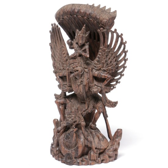 Figure of wood in the shape of Garuda and other mythical figures. Bali. H. 47 cm.