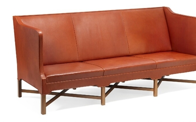 Kaare Klint: Freestanding three seater sofa on eight-legged, profiled mahogany cross-frame. Sides, seat and back upholstered with patinated red leather.
