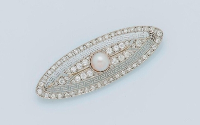 Oval shaped platinum brooch (950 thousandths) openworked with Greek friezes, set with 16x16 antique cut and rose cut diamonds, and set in the center with a button cultured pearl. Pin in 18-carat white gold (750 thousandths) bearing an illegible French...