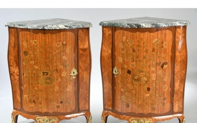 PAIR OF LARGE LOUIS XV COVERS with curved front and curved sides entirely inlaid with a rich floral decoration. They open by a door. They rest on small curved feet. Beautiful ornamentation of gilded bronzes. White marble top, veined green. Stamped with...