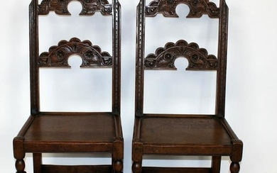 Pair of English oak carved back side chairs