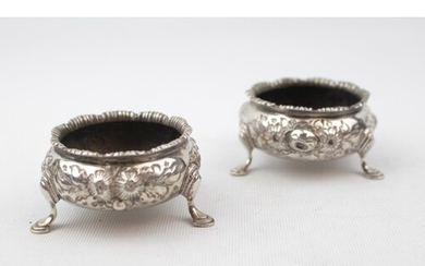 Pair of Mid Victorian Silver Floral ebossed Open salts suppo...