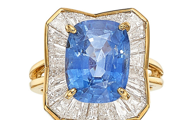 Sapphire, Diamond, Gold Ring The ring features a cushion-shaped...