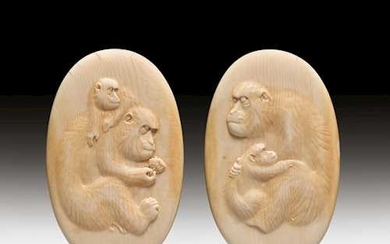 TWO MEDAILLONS FINELY CARVED WITH MONKEYS.