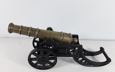 Vintage brass signalling canon with cast iron base overall l...