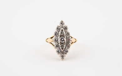 Yellow and white gold (750) navette ring set with brilliant-cut diamonds in claw setting.