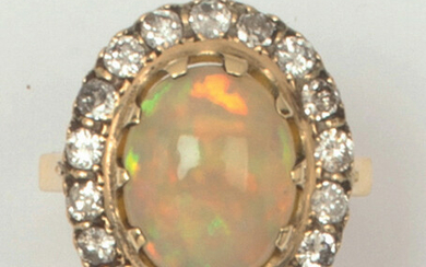 Yellow gold ring set with an oval opal...