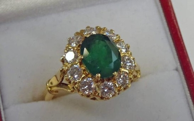 18CT GOLD, EMERALD AND DIAMOND CLUSTER RING, THE OVAL...
