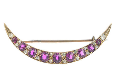 A late Victorian gold ruby and diamond brooch.
