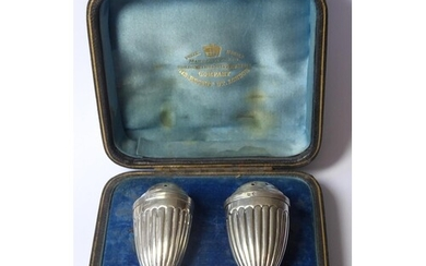 A CASED PAIR OF VICTORIAN C SILVER PEPPERETTES Classical for...