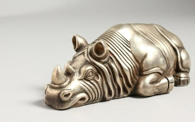 A CAST SILVER MODEL OF A RECUMBENT RHINOCEROS, marks to