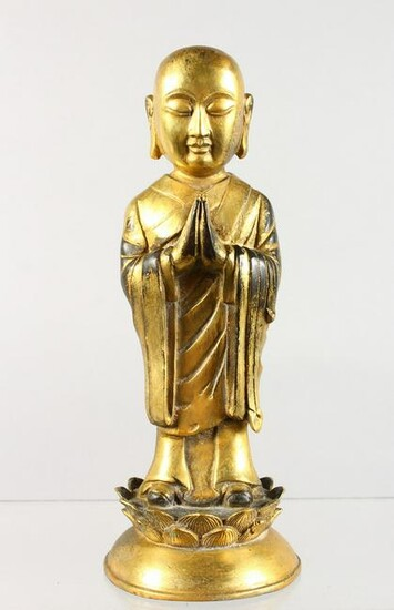 A CHINESE GILT BRONZE FIGURE, of a Buddha standing
