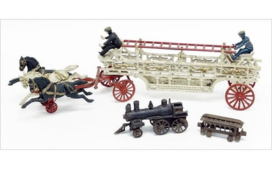 A Cast Iron Horse Drawn Fire Truck.