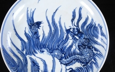 A Chinese blue and white porcelain dish, with painted dragon...