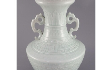 A Chinese celadon glazed two handled vase, finely decorated ...