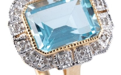A DECO STYLE TOPAZ AND DIAMOND RING; featuring a step cut light blue topaz to stepped border of round brilliant cut diamonds in 9ct...