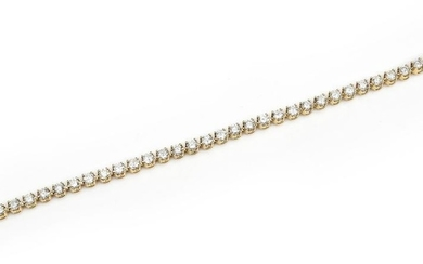 A DIAMOND LINE BRACELET-Comprising thirty eight round brilliant cut diamonds totalling 4.57cts, in 18ct gold, total length 180mm.