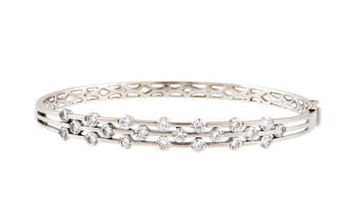 A DIAMOND SET BANGLE, of approx. 3.46ct in total, mounted in...