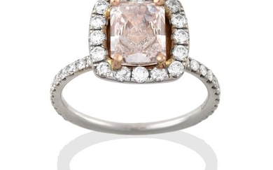 A Diamond Cluster Ring, the central fancy light brownish-pink emerald-cut...