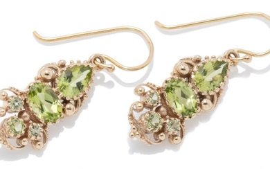 A PAIR OF 9CT VICTORIAN STYLE PERIDOT EARRINGS; each a cannetille style drop set with an oval, pear and round cut peridot, length 28...