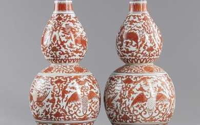 A PAIR OF CHINESE IRON-RED DOUBLE GOURD VASES