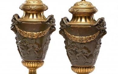 A PAIR OF LOUIS XV STYLE GILT AND PATINATED BRONZE URNS