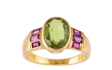 A PERIDOT SINGLE STONE RING, to ruby shoulders, mounted in y...