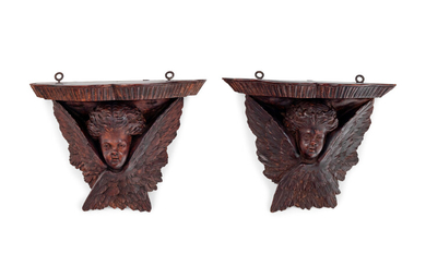 A Pair of Continental Carved Oak Brackets