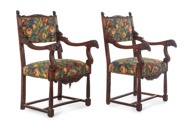 A Pair of Empire Style Carved Walnut Fauteuils