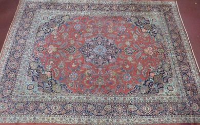 A Persian Kashan carpet, central floral medallion and stylis...