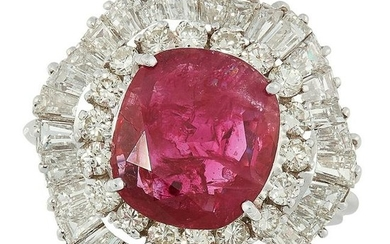 A RUBY AND DIAMOND CLUSTER RING set with a oval cushion