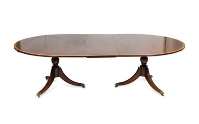 A Regency Style Satinwood Banded Mahogany Dining Table